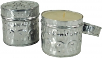 Exotic scented candle in pretty metal box